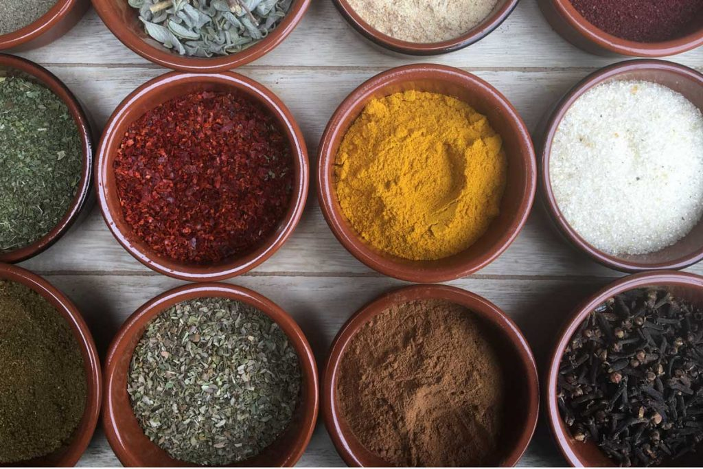 Overhead shot of old fashioned spices in small bowls.