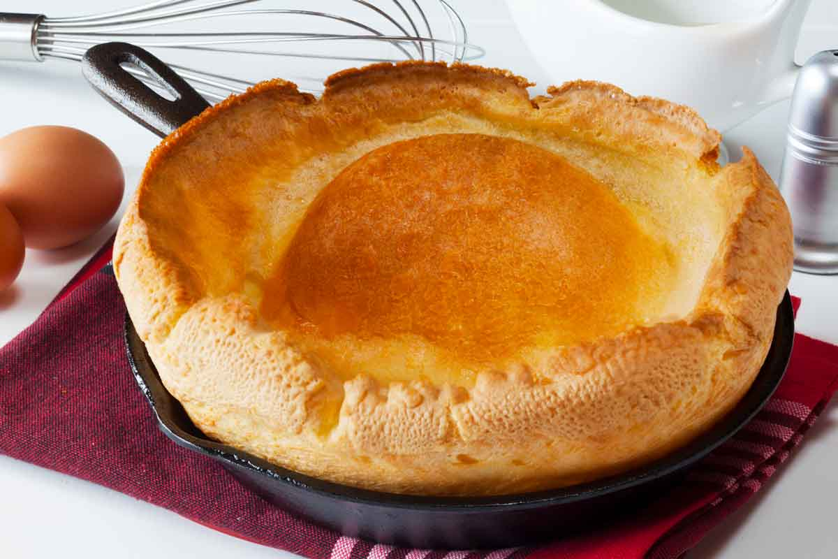 Traditiona large Yorkshire pudding in a cast iron skillet.